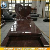 heart shaped rose carved headstone with red granite stone