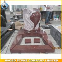 red angel tombstones designs with carved heart shapes